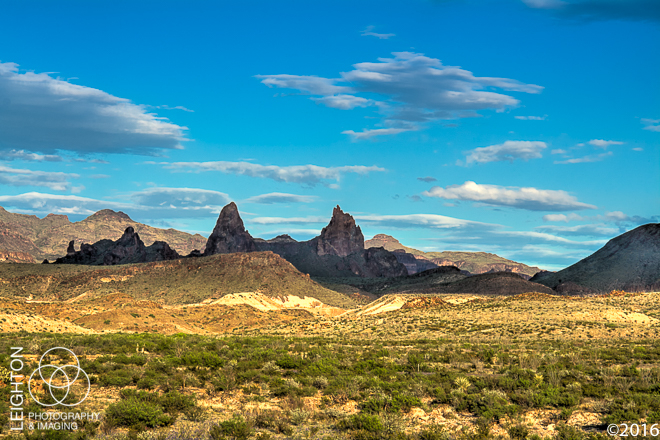 """One of the many great rock formations in the Chiso Mountains in Western Texas' Big Bend National Park and is known as the """"Mule Ear Peaks."""" These twin peaks are formed from a part of a dike-like intrusion of relatively young rhyolite, and rise about 1040 feet (3,881 above sea level) above the desert floor."""